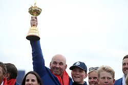 Team Europe captain Thomas Bjorn celebrates with the Ryder Cup trophy on day three of the Ryder Cup at Le Golf National, Saint-Quentin-en-Yvelines, Paris.