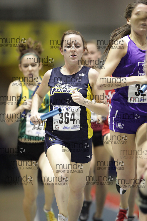 Windsor, Ontario ---13/03/09--- Carly Gill of  the University of Windsor competes in the 4X800 metre relay at the CIS track and field championships in Windsor, Ontario, March 13, 2009..GEOFF ROBINS Mundo Sport Images