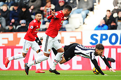 Chris Smalling of Manchester United bundles over Dwight Gayle of Newcastle United - Mandatory by-line: Matt McNulty/JMP - 11/02/2018 - FOOTBALL - St James Park - Newcastle upon Tyne, England - Newcastle United v Manchester United - Premier League