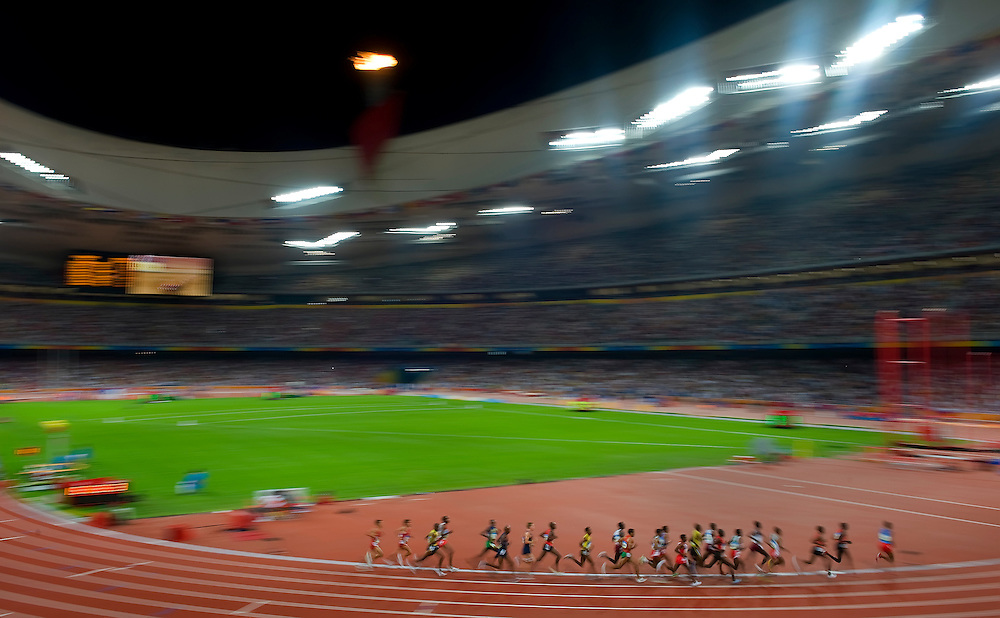 Athletes in the men's 10,000m final circle the track at National Stadium on August 17, 2008 during the 2008 Summer Olympic Games in Beijing, China. (photo by David Eulitt / MCT)