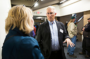 Operation Fresh Start board member David Lonsdorf, right, speaks with an attendee during the grand opening ceremony for Operation Fresh Start on Milwaukee Street in Madison, WI on Thursday, April 11, 2019.