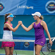 August 16, 2014, New Haven, CT:<br /> Michaela Gordon and Caitlin Whoriskey shake hands after playing each other in the 2014 US Open National Playoffs Women's final match on day four of the 2014 Connecticut Open at the Yale University Tennis Center in New Haven, Connecticut Monday, August 18, 2014.<br /> (Photo by Billie Weiss/Connecticut Open)