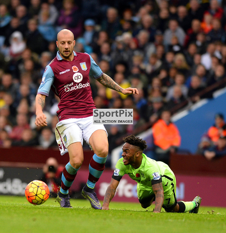 Manchester City player looks for a foul as Aston Villa looks to bring him down