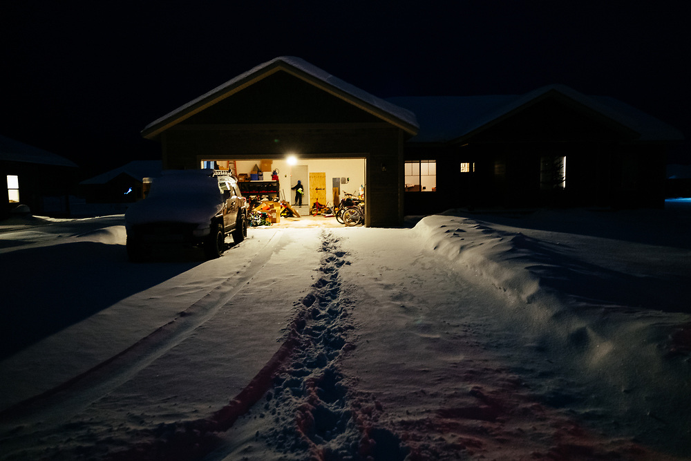 Micah Goodrich caries his ski boots into the house after a day of skiing.
