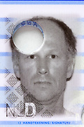 passport identity head and shoulder portrait on document with a hole in the paper