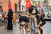An Aztec indian skeleton dances in a procession through the historic city during the week long fiesta of the patron saint Saint Michael September 24, 2017 in San Miguel de Allende, Mexico.