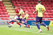 Crewe Alexandra midfielder Daniel Powell challenged by Exeter City defender Pierce Sweeney during the EFL Sky Bet League 2 match between Crewe Alexandra and Exeter City at Alexandra Stadium, Crewe, England on 5 October 2019.