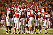 Nov 12, 2011; Fayetteville, AR, USA;  Arkansas Razorbacks offensive listens to quarterback Tyler Wilson (8) during a game against the Tennessee Volunteers at Donald W. Reynolds Razorback Stadium. Arkansas defeated Tennessee 49-7. Mandatory Credit: Beth Hall-US PRESSWIRE