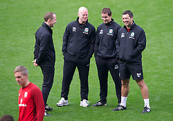 CARDIFF, WALES - Monday, October 15, 2012: Wales' Medical Officer Doctor Jon Houghton, physiotherapist Sean Connelly, sports science coach Adam Owen, head of fitness and science Ryland Morgans during a training session at the Cardiff City Stadium ahead of the Brazil 2014 FIFA World Cup Qualifying Group A match against Croatia. (Pic by David Rawcliffe/Propaganda)