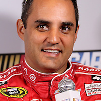 Juan Pablo Montoya speaks with the media during the NASCAR Media Day event at Daytona International Speedway on Thursday, February 14, 2013 in Daytona Beach, Florida.  (AP Photo/Alex Menendez)