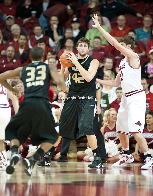 Nov 16, 2011; Fayetteville, AR, USA;  Oakland Grizzlies forward Corey Petros (42) looks to make a pass to guard Ryan Bass (33) under pressure from Arkansas Razorback forward Hunter Michelson (21).during a game at Bud Walton Arena. Mandatory Credit: Beth Hall-US PRESSWIRE
