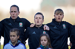ZENICA, BOSNIA AND HERZEGOVINA - Tuesday, November 28, 2017: Wales' goalkeeper Laura O'Sullivan, Hayley Ladd and Gemma Evans stand to sing the national anthem before the FIFA Women's World Cup 2019 Qualifying Round Group 1 match between Bosnia and Herzegovina and Wales at the FF BH Football Training Centre. (Pic by David Rawcliffe/Propaganda)