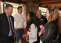 Governor Chris Sununu, Laconia Motorcycle Week Association President Cynthia Makris and Deputy Director Jennifer Anderson at Gunstock Resort during the kickoff event for the 95th Laconia Motorcycle Week on Thursday morning.  (Karen Bobotas/for the Laconia Daily Sun)