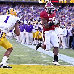 November 6, 2010; Baton Rouge, LA, USA;  Alabama Crimson Tide running back Mark Ingram (22) scores past LSU Tigers cornerback Eric Reid (1) the LSU Tigers during the second half at Tiger Stadium. LSU defeated Alabama 24-21.  Mandatory Credit: Derick E. Hingle