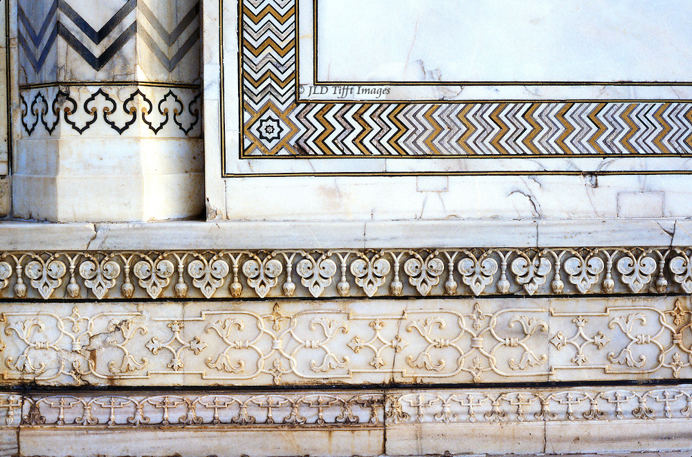 Detail of low relief marble foliate carved ornament on an exterior wall of the Taj Mahal..