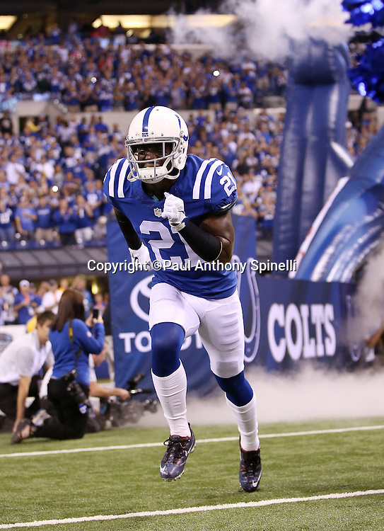 Indianapolis Colts cornerback Vontae Davis (21) runs onto the field during pregame player introductions before the 2015 NFL week 2 regular season football game against the New York Jets on Monday, Sept. 21, 2015 in Indianapolis. The Jets won the game 20-7. (©Paul Anthony Spinelli)
