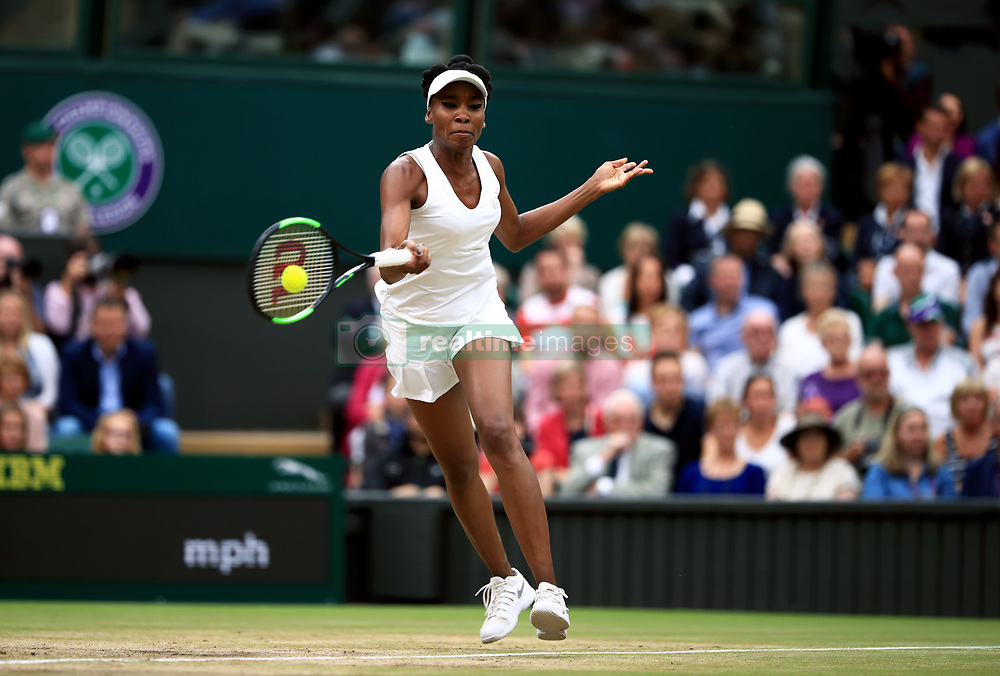 Venus Williams in action against Garbine Muguruza in the Ladie's Singles final on day twelve of the Wimbledon Championships at The All England Lawn Tennis and Croquet Club, Wimbledon.