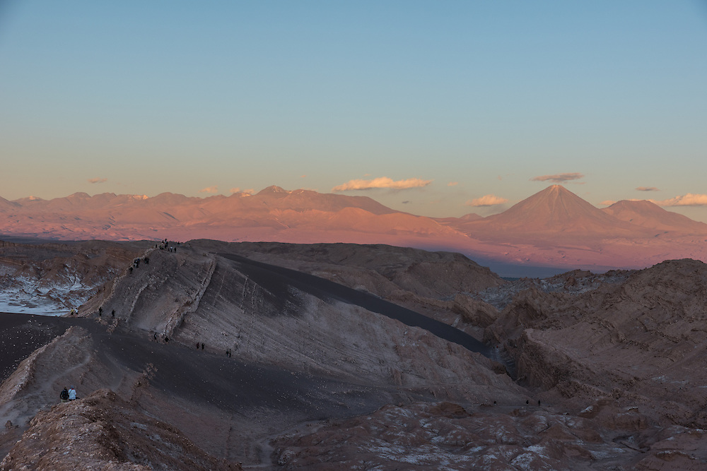 The moonlike landscape of the Valley of the Moon at sunset. On the background the Andes mountain range, Chile.