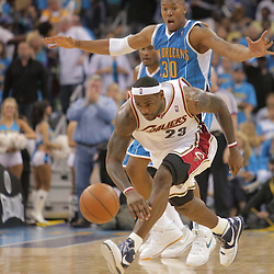 01 November 2008:  New Orleans Hornets guard Devin Brown (23) chases down a loose ball as New Orleans Hornets forward David West (30) watches during a 104-92 win by the New Orleans Hornets over the Cleveland Cavaliers at the New Orleans Arena in New Orleans, LA..