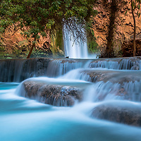 Cascading waterfalls flowing from the Giant Mooney Falls.  Havasupai AZ
