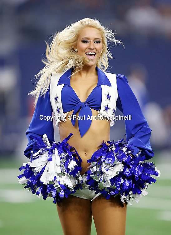 A Dallas Cowboys cheerleader performs during the Dallas Cowboys 2015 NFL preseason football game against the Houston Texans on Thursday, Sept. 3, 2015 in Arlington, Texas. The Cowboys won the game 21-14. (©Paul Anthony Spinelli)