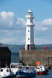 Lighthouse and boats in harbour on Firth of Forth at Newhaven in Edinburgh, Scotland, United Kingdom