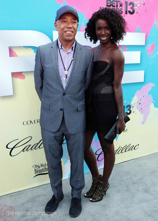 "Los Angeles, CA-June 29:  Music Executive Russell Simmons and Guest attend the Seventh Annual "" Pre "" Dinner celebrating BET Awards hosted by BET Network/CEO Debra L. Lee held at Miulk Studios on June 29, 2013 in Los Angeles, CA. © Terrence Jennings"