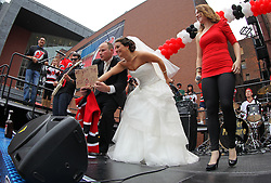 June 9, 2012; Newark, NJ, USA;  A bride and groom celebrate their marriage before Game 5 of the 2012 Stanley Cup Finals at the Prudential Center.