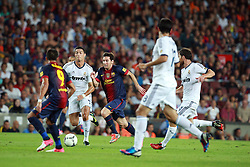 Lionel Messi attacks for Barcelona as Cristiano Ronaldo of Real Madrid attempts to tackle him.  Barcelona v Real Madrid, Supercopa first leg, Camp Nou, Barcelona, 23rd August 2012...Credit - Eoin Mundow/Cleva Media.