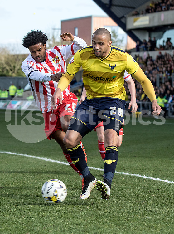 Jordan Bowery of Oxford United and Bradley Pritchard of Stevenage during the Sky Bet League 2 match between Oxford United and Stevenage at the Kassam Stadium, Oxford, England on the 25th March 2016. Photo by Liam McAvoy.