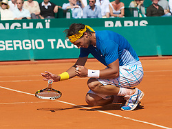 MONTE-CARLO, MONACO - Sunday, April 18, 2010: Rafael Nadal (ESP) collapses to the clay after winning the the Men's Singles Final on day seven of the ATP Masters Series Monte-Carlo at the Monte-Carlo Country Club. This was Nadal's sixth straight victory in the tournament, setting a record for the most Masters Series consecutive victories at a single tournament by any player. (Photo by David Rawcliffe/Propaganda)\
