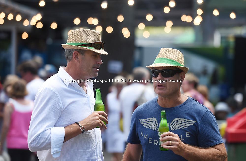Tennis fans enjoy a beer on Day 3 at the Heineken Open. Festival of Tennis, ATP World Tour. ASB Tennis Centre, Auckland, New Zealand. Wednesday 14 January 2015. Copyright photo: Andrew Cornaga/www.photosport.co.nz