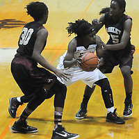 New Hanover's Kayleigh Merrell is guarded by Ashley's Chyna Cotten, left, and Jada Bacchus Friday December 19, 2014 at New Hanover High School in Wilmington, N.C. (Jason A. Frizzelle)