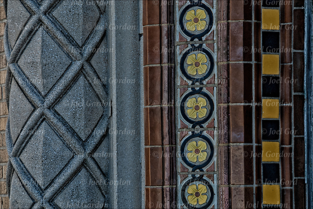 Architectural details of repeating  and repetition of decorative titles and patterns and design of columns or pillars on side of door entrance of nineteen century  building in Atlantic City, NJ