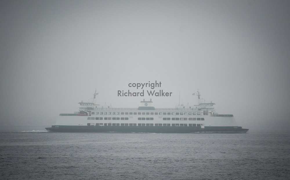 2013 October 24 - A Washington State ferry sails in heavy fog on Puget Sound off Alki, Seattle, WA. By Richard Walker