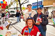 Three Auxiliary members of American Legion post fundraising at Merrick Street Fair in Merrick, New York, USA, on October 22, 2011
