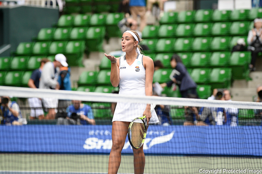 SEPTEMBER 21: Monica Puig of Puerto Rico Olympic gold medal winner celebrate her victory against Petra Kvitova of Czech Repuplic during women's singles match day three of the Toray Pan Pacific Open at Ariake Colosseum on September 21, 2016 in Tokyo, Japan 21/09/2016-Tokyo, JAPAN