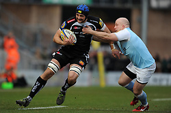 Exeter Chiefs Dean Mumm is tackled by Newcastle Falcons Scott Lawson  - Photo mandatory by-line: Harry Trump/JMP - Mobile: 07966 386802 - 14/02/15 - SPORT - Rugby - Aviva Premiership - Sandy Park, Exeter, England - Exeter Chiefs v Newcastle Falcons