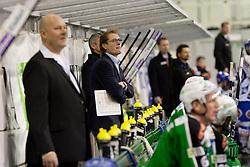 Hannu Järvenpää, head coach of HDD Tilia Olimpija, and Brad Cole (HDD Tilia Olimpija, #2) during ice-hockey match between HDD Tilia Olimpija and EC Rekord Fenster VSV in 38th Round of EBEL league, on Januar 6, 2012 at Hala Tivoli, Ljubljana, Slovenia. (Photo By Matic Klansek Velej / Sportida)