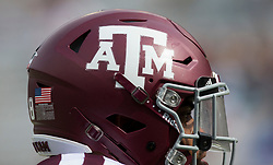 A Texas A&M lineman goes through drills before the start of an NCAA college football game against Louisiana-Lafayette Saturday, Sept. 16, 2017, in College Station, Texas. (AP Photo/Sam Craft)