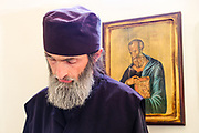 A Serbian Orthodox monk, one of only two in residence, bows his head in prayer during an afternoon liturgy at Dobrun monastery near Visegrad, Bosnia and Herzegovina.