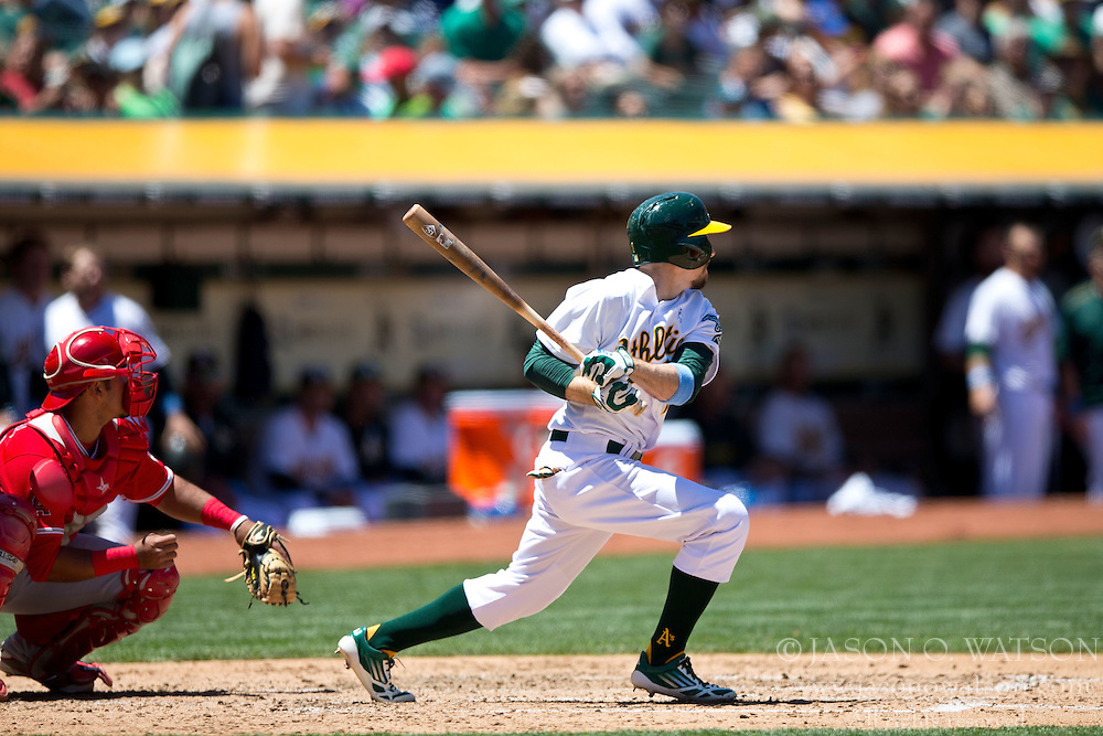 OAKLAND, CA - JUNE 21:  Billy Burns #1 of the Oakland Athletics hits an RBI single against the Los Angeles Angels of Anaheim during the third inning at O.co Coliseum on June 21, 2015 in Oakland, California. The Oakland Athletics defeated the Los Angeles Angels of Anaheim 3-2. (Photo by Jason O. Watson/Getty Images) *** Local Caption *** Billy Burns
