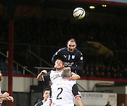 Dundee's James McPake outjumps Inverness' Garry Waren - Dundee v Inverness Caledonian Thistle, SPFL Premiership at Dens Park <br /> <br />  - &copy; David Young - www.davidyoungphoto.co.uk - email: davidyoungphoto@gmail.com