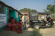 Collection centre owner Ganesh Kumar Singh (in white shirt), 30, loads a rickshaw with vegetables to be delivered to buyers from his collection centre in Machahi village, Muzaffarpur, Bihar, India on October 27th, 2016. Ganesh and his wife, Asha Devi, a producer group member, rent out a part of their house to be used as a collection centre for Producer Group farmers. Non-profit organisation Technoserve works with women vegetable farmers in Muzaffarpur, providing technical support in forward linkage, streamlining their business models and linking them directly to an international market through Electronic Trading Platforms. Photograph by Suzanne Lee for Technoserve