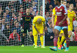 LONDON, ENGLAND - Saturday, September 20, 2014: Liverpool's goalkeeper Simon Mignolet looks dejected as West Ham United score the opening goal during the Premier League match at Upton Park. (Pic by David Rawcliffe/Propaganda)