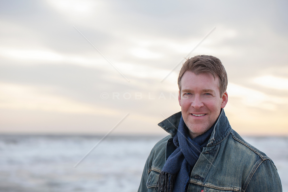 Portrait of a rugged and handsome middle aged man with blue eyes outdoors in The Hamptons