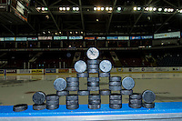 KELOWNA, CANADA - MARCH 18: Pucks stand on the boards prior to warm up between the Kelowna Rockets and the Seattle Thunderbirds on March 18, 2015 at Prospera Place in Kelowna, British Columbia, Canada.  (Photo by Marissa Baecker/Shoot the Breeze)  *** Local Caption *** pucks;