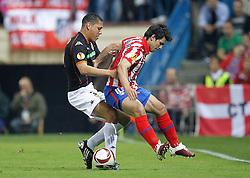 08-04-2010 VOETBAL: CHAMPIONS LEAGUE: ATLETICO MADRID - VALENCIA: MADRID<br /> Hedwiges Maduro (Val) and Sergio Kun Aguero<br /> ©2010-FRH-nph / Cebolla-Cid-Fuentes