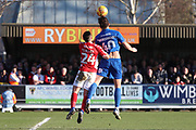 AFC Wimbledon midfielder Anthony Wordsworth (40) beating Charlton Athletic midfielder Josh Cullen (24) to a header during the EFL Sky Bet League 1 match between AFC Wimbledon and Charlton Athletic at the Cherry Red Records Stadium, Kingston, England on 23 February 2019.