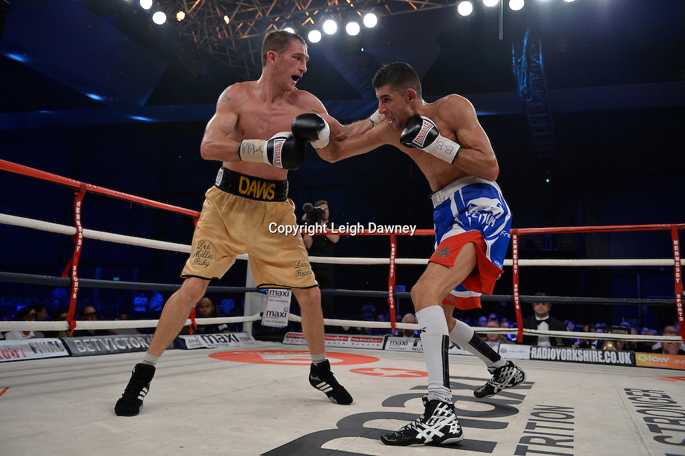 Lenny Daws (left) claims the Vacant EBU Light Welterweight Title at Glow, Bluewater, Kent following his fight with Chaquib Fadli on the 8th November 2014. Promoter: Hennessy Sports. © Leigh Dawney Photography 2014.